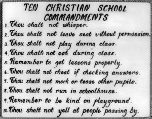 This set of rules was hand painted on glass. A small metal chain was fastened to the edges for a frame. It was lost in a fire when the school was burned down by vandals.